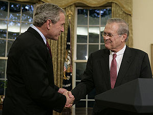 Known and Unknown: A Memoir - Rumsfeld shakes President Bush's hand as he announces his resignation in November 2006.