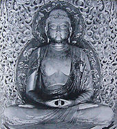 Front view of a cross-legged seated statue, showing the meditation gesture (Dhyāna Mudrā) with both hands placed on the lap, palms facing upwards.