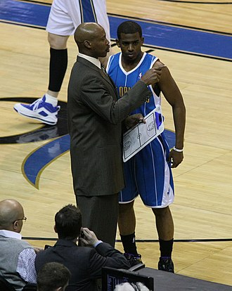 Chris Paul - Paul speaks with Hornets coach Byron Scott in March 2009.