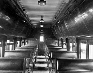 Colonist car - Interior of Canadian National Railways colonist car, 1926. Note lowered sleeping berths at end of car.