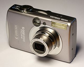 Point-and-shoot camera still camera designed primarily for simple operation