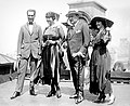 Caruso's wedding party on the roof of the Knickerbocker Hotel (New York), August 20, 1918. Left to right Bruno Zirato (Caruso's personal assistant), Dorothy Caruso, Enrico Caruso, Mrs. J. S. Keith.jpg