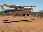 Cessna 210 V5-WAH, landing at Lake Oanob Resort.jpg