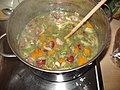 Chicken and Sausage Gumbo- Cooking with stock, meat, and spices.jpg