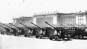 10th anniversary of the People's Republic of China - Anti-aircraft guns in the military parade before the Great Hall of the People.
