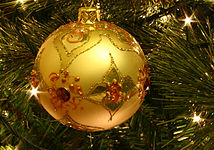 a golden bauble decorating a christmas tree - A Christmas Tree