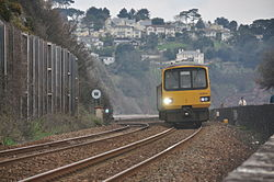 Class 143 on the sea wall at Teignmouth (0159).jpg