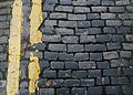 Cobbles and double yellows (23227426716).jpg