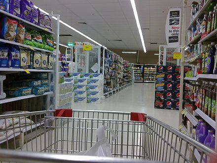 A pet food and cleaning aisle of a supermarket. Coles South City aisle 1.jpg