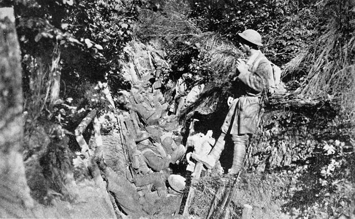 Collier's 1921 World War - American soldiers rest in trench in Argonne Forest.jpg