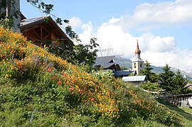 Colourfull flowers at the mountain village Les Chapelles with its church - panoramio.jpg