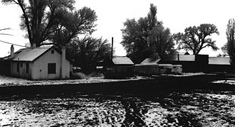 Fred Colter - Blacksmith shop, bunkhouse, log cabin, shed, and commissary on the Colter Ranch