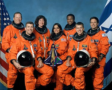 Crew of the final ill-fated flight of the Space Shuttle Columbia, mission STS-107. This is the official crew photo from mission STS-107 on the Space Shuttle Columbia. From left to right are mission specialist David Brown, commander Rick Husband, mission specialist Laurel Clark, mission specialist Kalpana Chawla, mission specialist Michael Anderson, pilot William McCool, and Israeli payload specialist Ilan Ramon.  All were killed when the shuttle disintegrated over Texas.