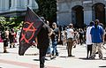 Crowd outside California State Capitol after riot anarchist flag debris.jpg