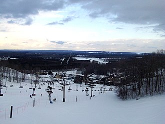 """Crystal Mountain (Michigan) - View of the """"Cheers"""" chair lift and resort from near one of the peaks. Thompsonville air strip (7Y2) visible in the background"""