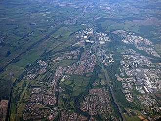 Carrickstone - The bottom of the picture shows Balloch from the air between Eastfield Road and the M80. The Forth and Clyde canal is to the left with the railway between it and Cumbernauld Town Centre to the right. Further north is Carrickstone beyond which the M80 divides Wardpark in two.