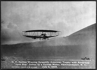 Glenn Curtiss - The June Bug on its prize-winning historic flight with Curtiss at the controls