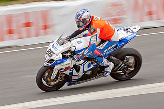 Josh Brookes - Brookes on the Tyco Suzuki 1000 cc entering Governor's Bridge during the 2013 TT Superbike race