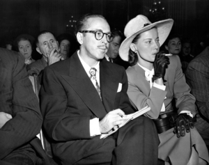 Cigarette holder - Cleo Trumbo, wife of novelist Dalton Trumbo, smokes with a holder during House Un-American Activities Committee hearings in 1947