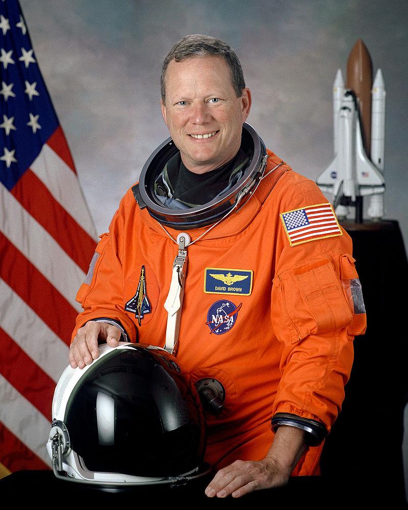 David M. Brown, NASA photo portrait in orange suit.jpg