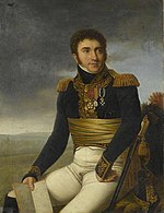 Painting depicts a curly-haired man, sitting with his right hand holding a map and left hand resting awkwardly on his leg. He wears a dark blue military coat with epaulettes and white breeches.