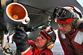 Defense.gov News Photo 110520-N-1004S-996 - U.S. Navy Seaman Korey Chavis left installs wing and fin attachments to an AIM-120 AMRAAM missile while Seaman John Chang right observes aboard the.jpg
