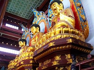 Trikaya - Three buddha statues symbolizing the Three Bodies. Dharma Flower Temple, Huzhou, Zhejiang province, China