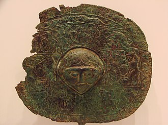History of the Lurs - Zoom of a disc-headed pin (pin, female figure). Found in Lorestan, Rietberg Museum, Zürich
