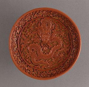 Lacquerware - Diaoqi or carved lacquer dish with dragon amid clouds, China, Ming dynasty, Wanli era (1573-1620)