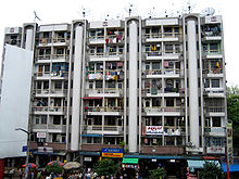 A block of flats in downtown Yangon, facing Bogyoke Market. Much of Yangon's urban population resides in densely-populated flats.