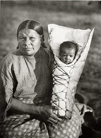 Comanche mother and baby son in cradleboard, photo by Edward Curtis Edward S. Curtis Collection People 003.jpg