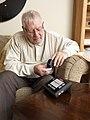 Elderly Man Using Pulse Oximeter.jpg