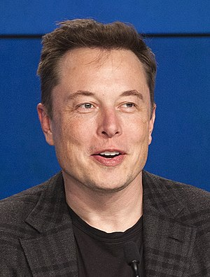 A close-up of Musk's face while giving a speech