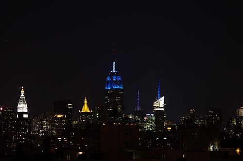 The Empire State Building lit with blue lights on September 12, 2011, in honor of the memorial's opening Empire State Building blue blue blue 2011 Shankbone.JPG