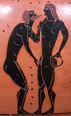 Escena de un cortejo pederasta Detalle de una ánfora ateniense del siglo V adC. El hombre con barba es descrito en un tradicional gesto de cortejo pederasta, una mano buscando acariciar al hombre joven, la otra agarrando su barbilla como para mirarlo en el ojo.