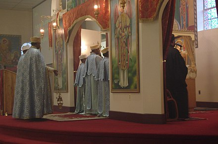 Priests and deacons conducting a church service at St. Michael Ethiopian Orthodox Tewahedo Church, Washington, DC. Ethio-orthodox-priests.jpg