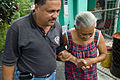 FEMA - 39054 - Mayor Marquest helps a resident in Puerto Rico.jpg