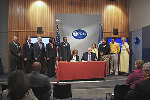 Legal Services Corporation - John Eidleman, Senior Program Counsel of Legal Services Corporation, standing next to Federal Emergency Management Agency Administrator W. Craig Fugate and American Red Cross President and CEO Gail J. McGovern in Washington, D.C. on October 22, 2010.