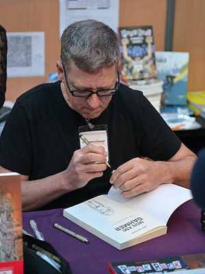 Derf - Derf at the 2015 Angoulême International Comics Festival, signing copies of the French edition of My Friend Dahmer