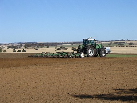 Tilling an arable field Fendt Tractor Ripping up Kulin.jpg