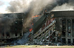 Firefighters work to put out the flames moments after a hijacked jetliner crashed into the Pentagon at approximately 0930 on September 11, 2001 010911-M-CI426-051.jpg