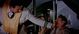 Slapping (strike) - John Wayne slapping Robert Stack in the 1954 film The High and the Mighty.