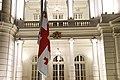 Flag of Georgia Lowered in front of Orbeliani Palace.jpg