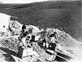 Four men shoveling dirt into rockers at the Albert Cavanaugh Claim, Gold Hill, Yukon Territory, ca 1898 (CURTIS 1352).jpeg