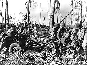 37 mm Gun M3 - Men of the 7th Division, US Army move a gun up to the front line on Kwajalein.