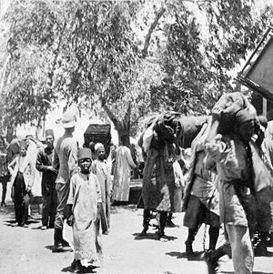 Wadi Halfa - Chained Sudanese prisoners carrying British baggage through Wadi Halfa in 1898.