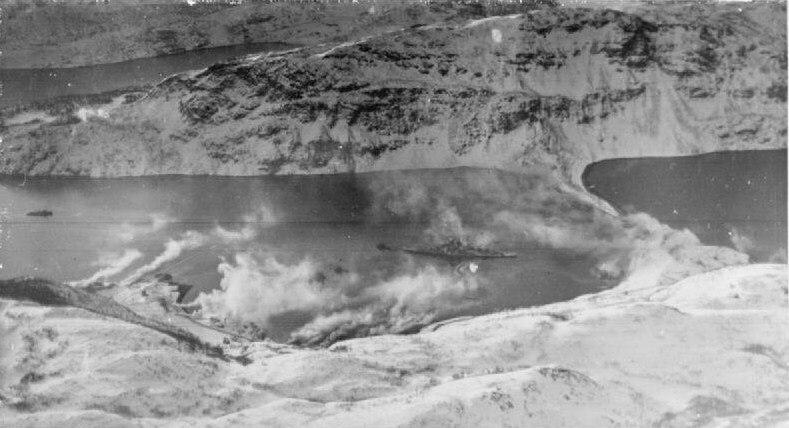 German battleship Tirpitz partly covered by a smokescreen at Kaafjord A22634