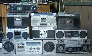 An assortment of early boomboxes.