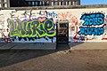 Graffiti at East Side Gallery Border, Berlin (32881375997).jpg