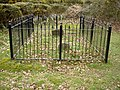 Grave in the woods - geograph.org.uk - 1219413.jpg